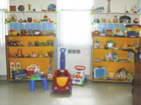 "toys available to be ""checked out"" sitting on shelves"
